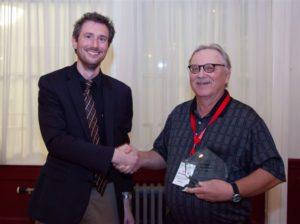Art Springsteen receiving CNIRS honorary lifetime membership award